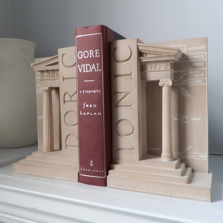 Doric / Ionic Order Bookend Set £60 / RRP £150 (Height 23cm) The First and Second Order of Greek Architecture These Timothy Richards bookends of the first and second order of Greek architecture would make a beautiful display in any study or office, on bookshelves or windowsill. This would be a striking gift for any student or professional architect looking for a place to keep their many books. DORIC – The bookend illustrates all the classical features of the Greek Order. The detail is taken directly from the Parthenon, Athens BC447/43. IONIC – This bookend is characterised by a capital composed of opposing scrolls known as volutes. This detail is taken from the Temple of Athena Nike BC425.