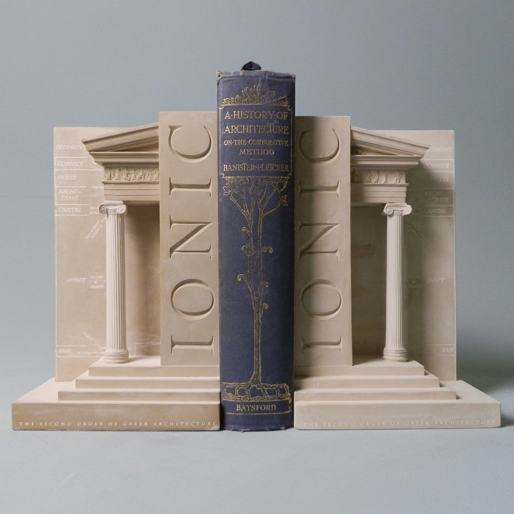 Ionic Order Bookend Set £23 / RRP £150 (height 23cm) The Second Order on Greek Architecture. IONIC – This bookend is characterised by a capital composed of opposing scrolls known as volutes. This detail is taken from the Temple of Athena Nike BC425.