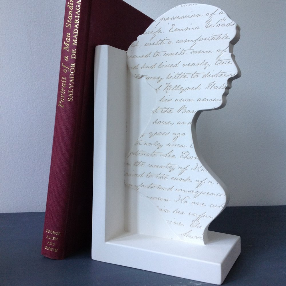Jane Austen lived in Bath for many years using the city and society as  inspiration for her novels.  These bookends were made in Bath by the Revival Arts Workshop and cast in British Gypsum Plaster. They are engraved with Jane Austen's own handwriting.  From an original idea by Bethanie Davis. Developed by Timothy Richards