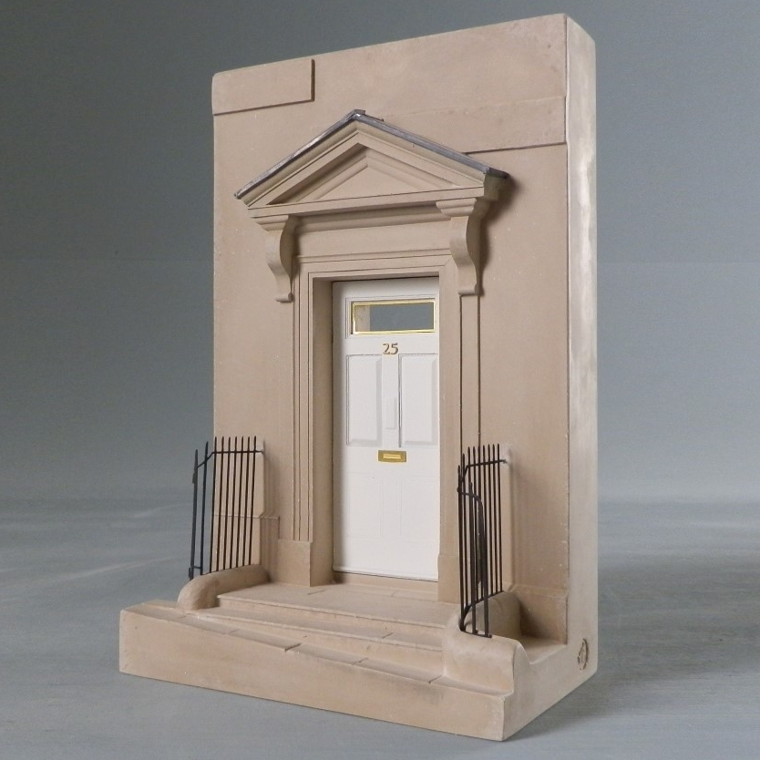 Designed by John Wood the Elder When – 1735 Where – Bath, England This detailed scale Timothy Richards doorway model would make a beautiful statement piece for any mantelpiece, bookshelf or display cabinet next to the complete works of the much loved author. The Georgian town house is now famous by its association to Jane Austen. Jane Austen (1775 – 1817) spent a great deal of her adult life in Bath. She lived at 25 Gay Street from 1805 onwards where she moved with her mother sister after the death of her father. Built of Bath stone the terraced row leads up to the circus and The Royal Crescent. Living here one could not help but engage in and observe Bath society as featured in many of her novels. This model was developed as Tim wished to include the house of one of Bath's most famous inhabitants. The pediment over the doorway is covered in beaten lead, a detail replicated in them model.