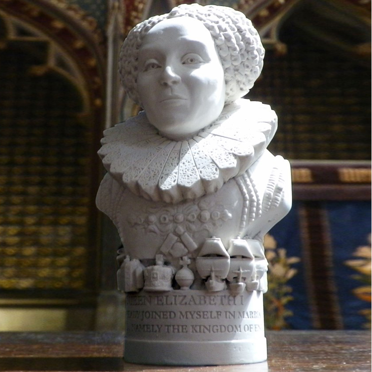 "Sometimes called The Virgin Queen, Gloriana, or Good Queen Bess, Elizabeth was the 5th monarch of the Tudor dynasty. The daughter of Henry VIII, her reign is celebrated as a golden age for England. The Base There are objects around the base of the bust depicting events and places from Elizabeth I reign.. For this bust we have included The Spanish Armada, musical instruments from court including the lute, harp and drum along with the Globe Theatre, the crown and orb and Sir Walter Raleigh. The etch around the base reads - ""I HAVE ALREADY JOINED MYSELF IN MARRIAGE TO A HUSBAND, NAMELY THE KINGDOM OF ENGLAND"""