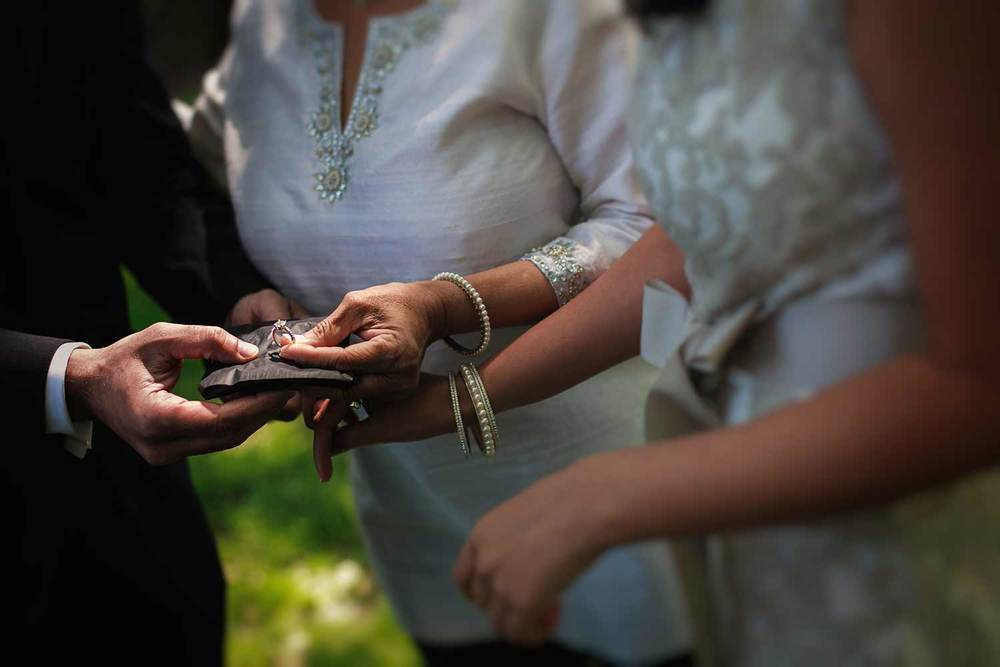 checking out the wedding ring before a civil ceremony in the Boston Public Garden