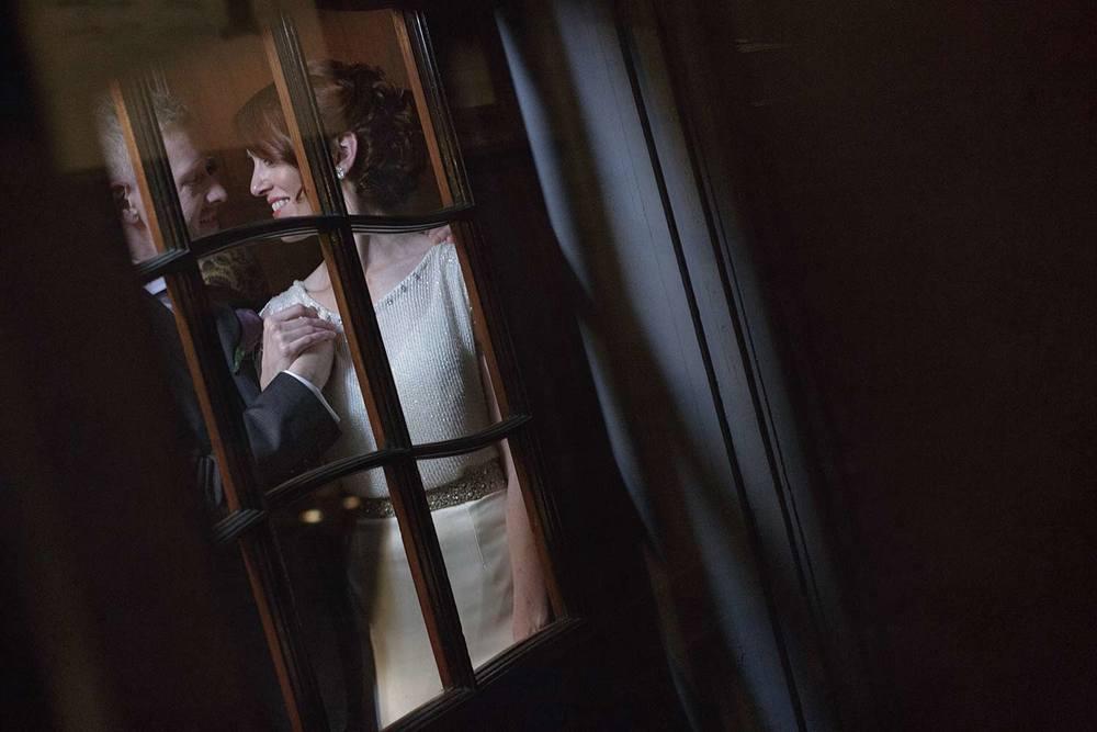 romantic moment caught through windows at the BU castle