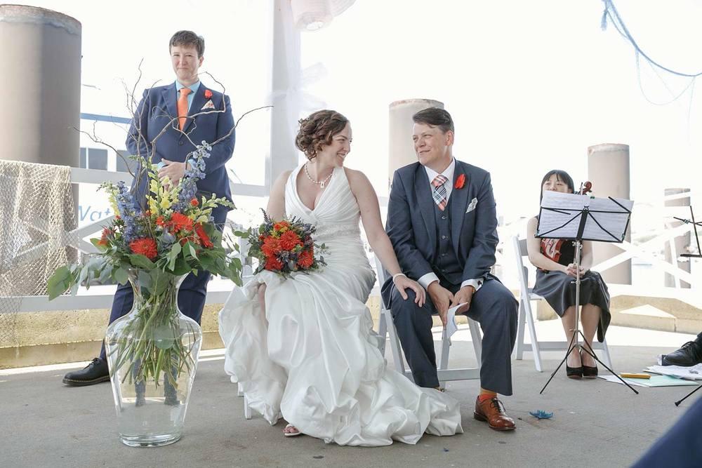brides at wedding ceremony at MacMillan Pier Provincetown, Massachusetts