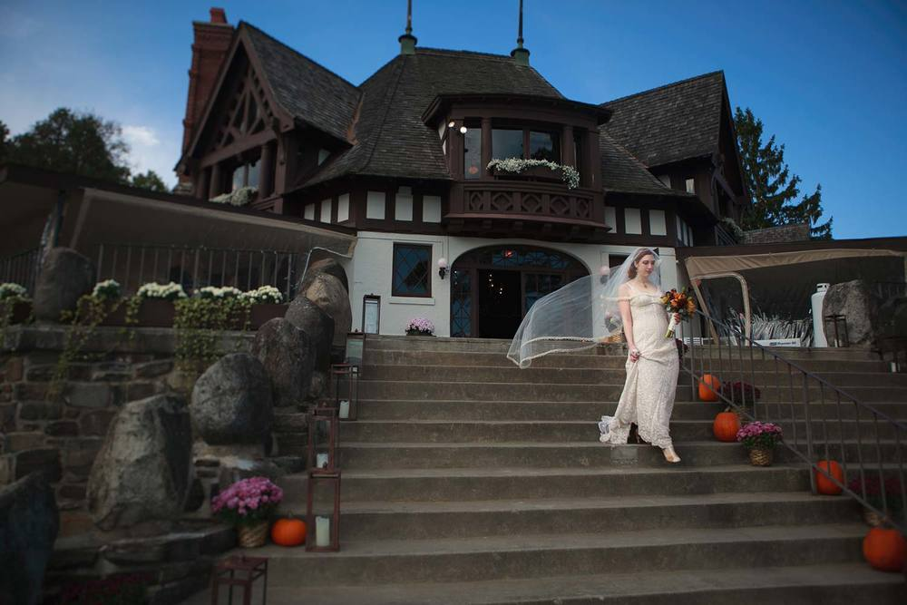 bride walking to the ceremony at the Lake George Club in New York