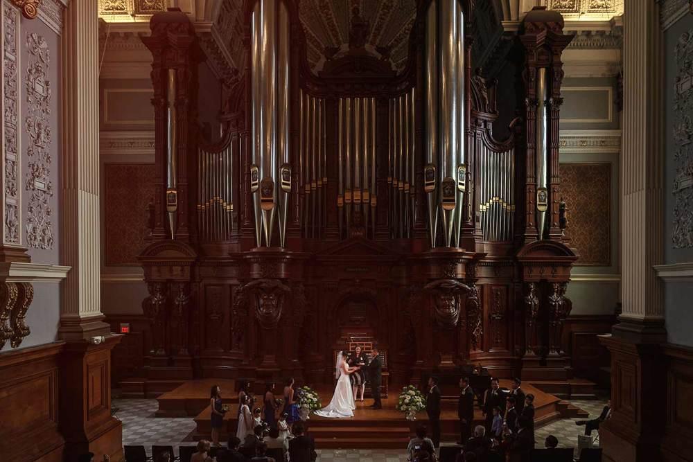 wedding ceremony under the organ at the Methuen Music Hall