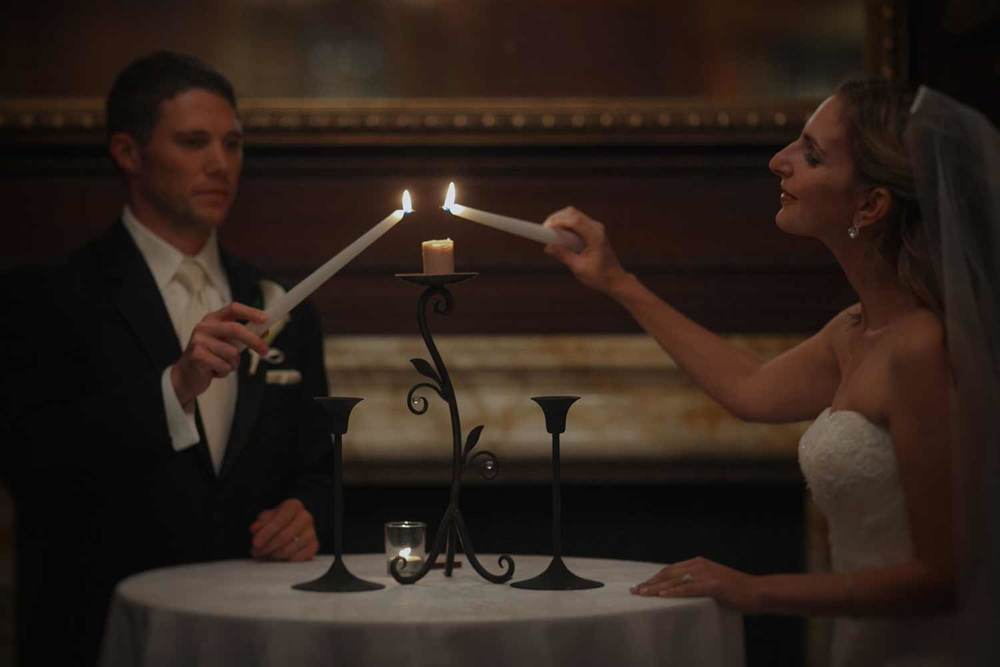 lighting the unit candle at the Omni Parker House press room weding ceremony