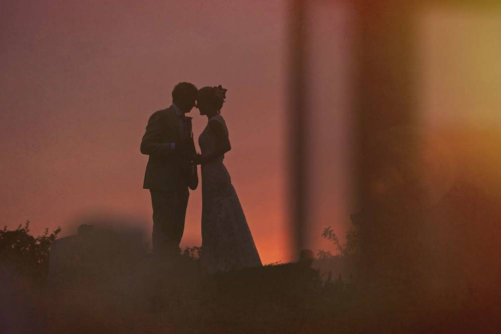 Stunning sunset at outdoor summer wedding at private home in Chatham on Cape Cod
