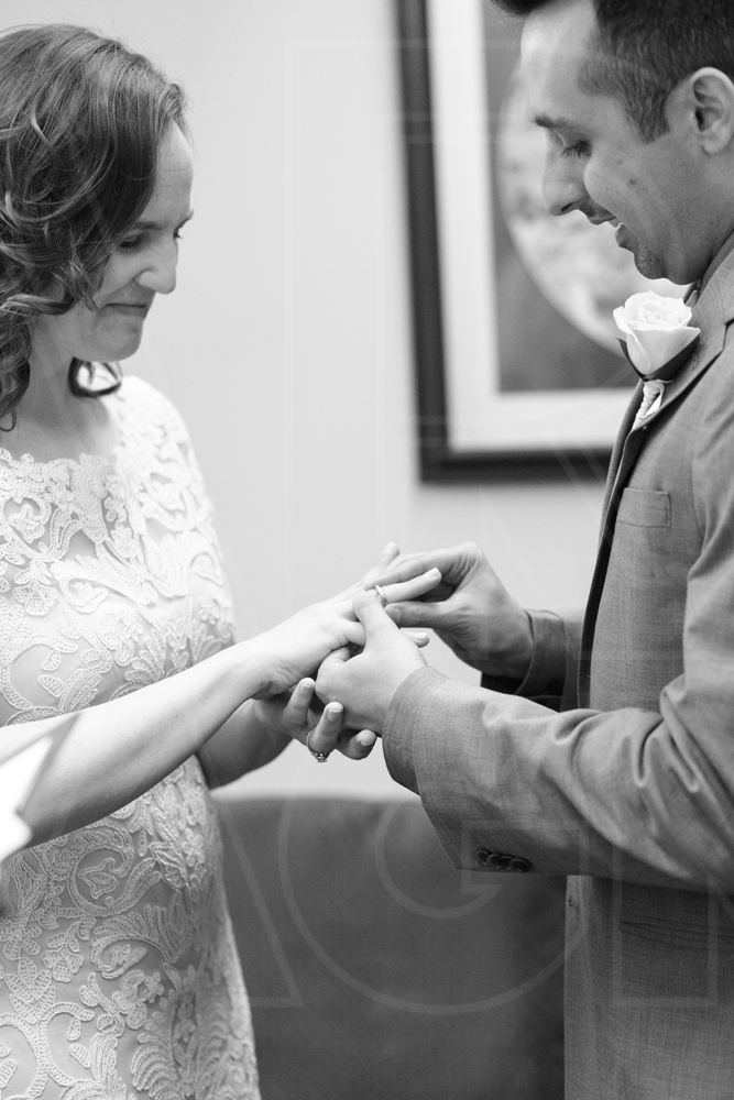 exchanging rings at Boston City Hall wedding ceremony