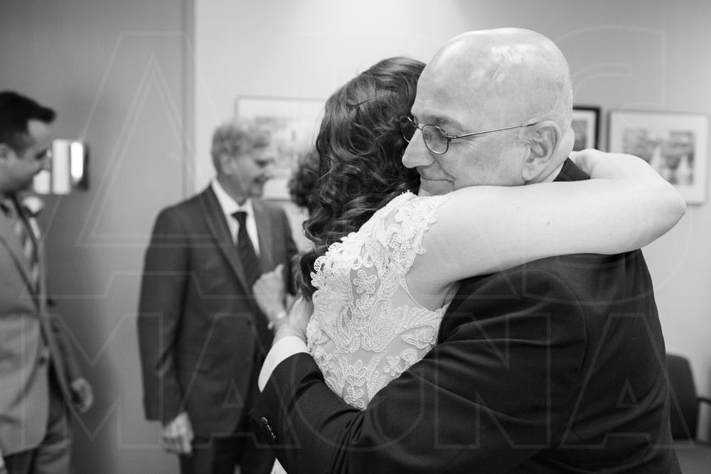 hugs after Boston City Hall wedding