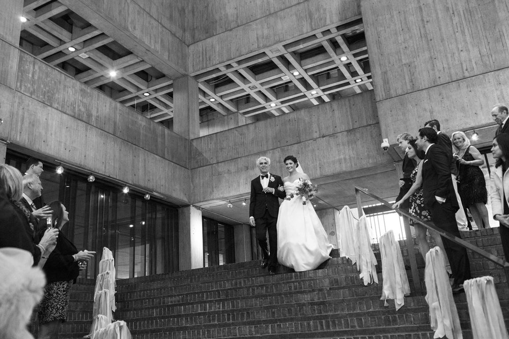bride and father walking down aisle at boston city hall civil wedding ceremony photography