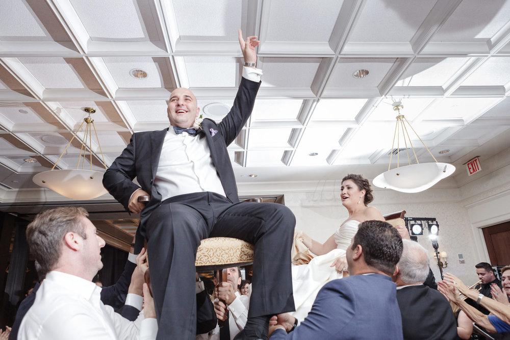 bc club wedding photographer horah groom on chair