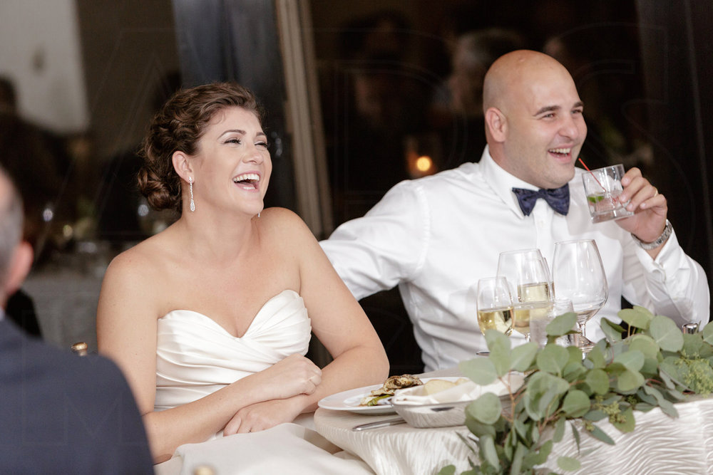 boston wedding photography bride and groom laughing during toasts at bc club wedding reception