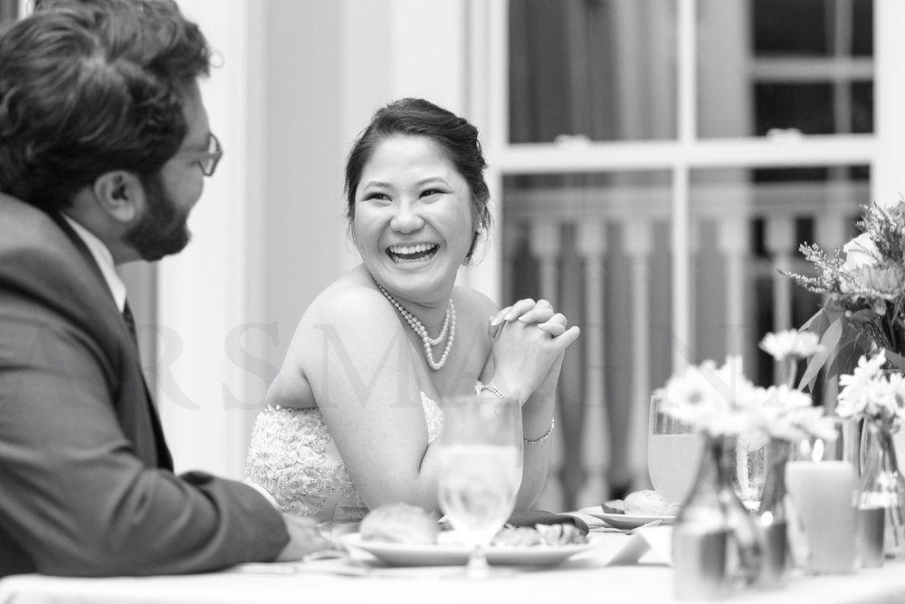 shalin liu wedding reception photography bride laughing during toas