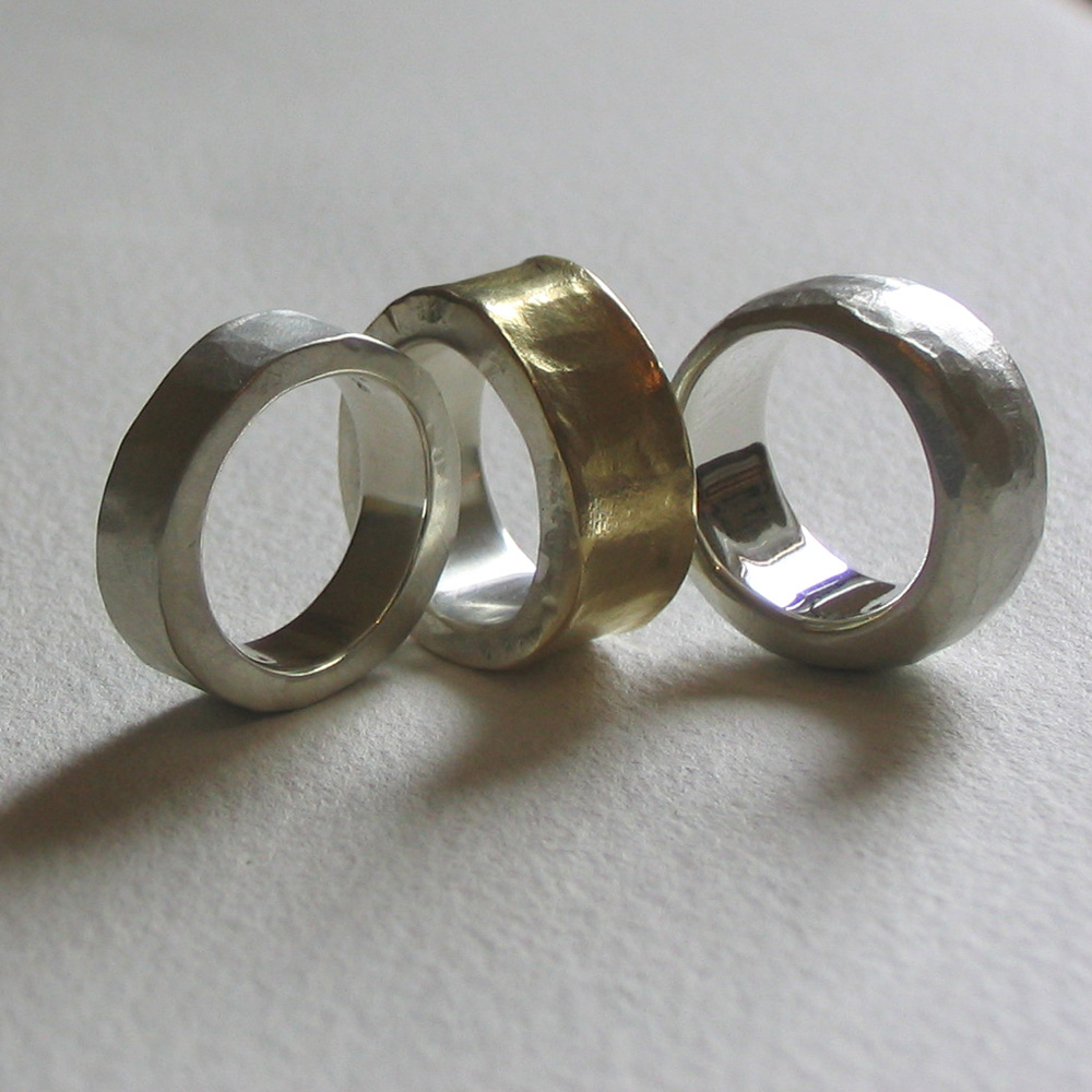 Hammered silver and gold rings
