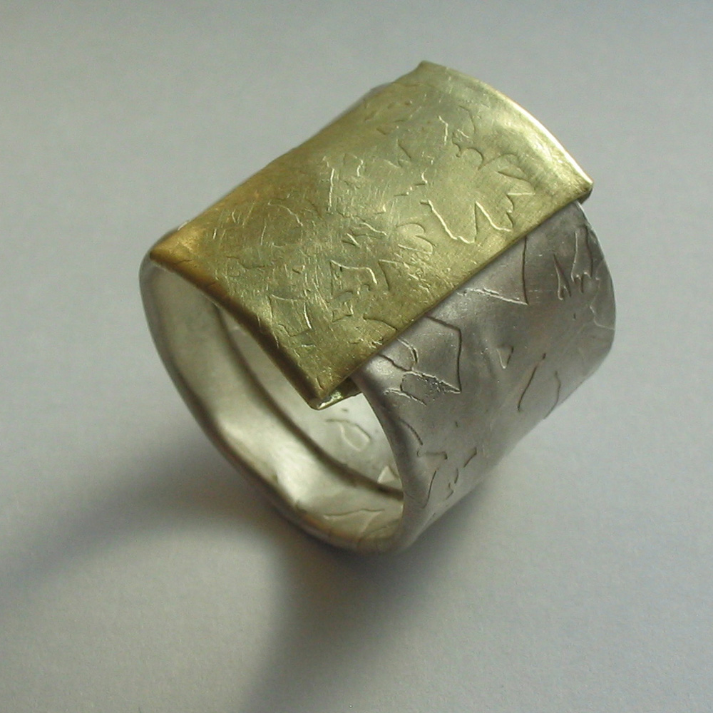 Wrapped islver and 18ct gold etched ring