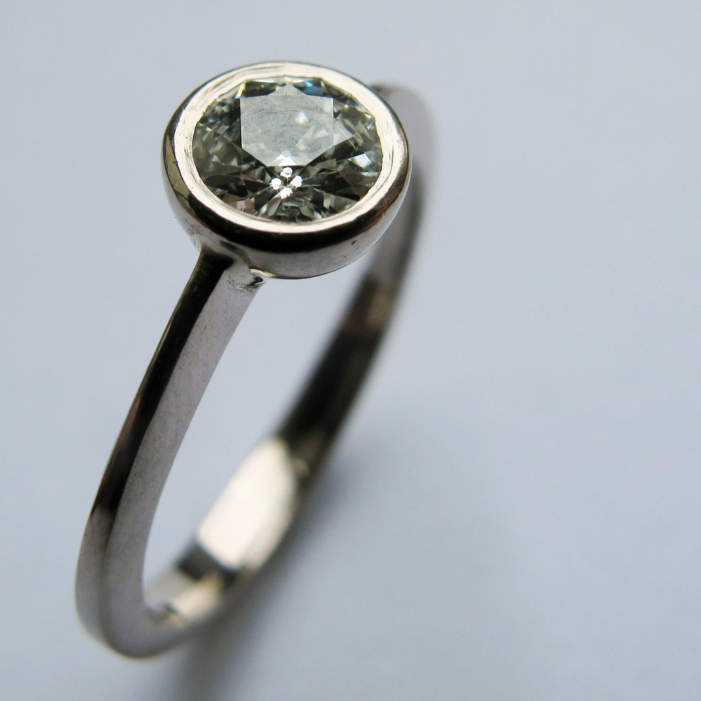 Grannies diamonds reset in an engagement ring.
