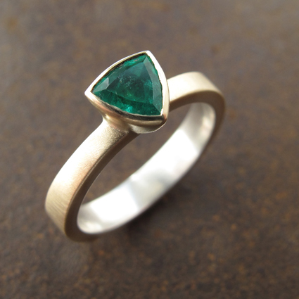 Trillion cut emerald and 9ct gold engagement ring.