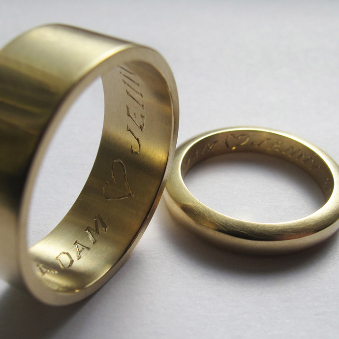 Hand engraved wedding rings in 18ct yellow gold.
