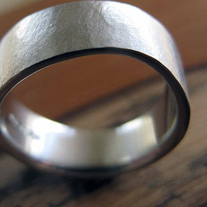 Textured platinum wedding ring with an organic finish.