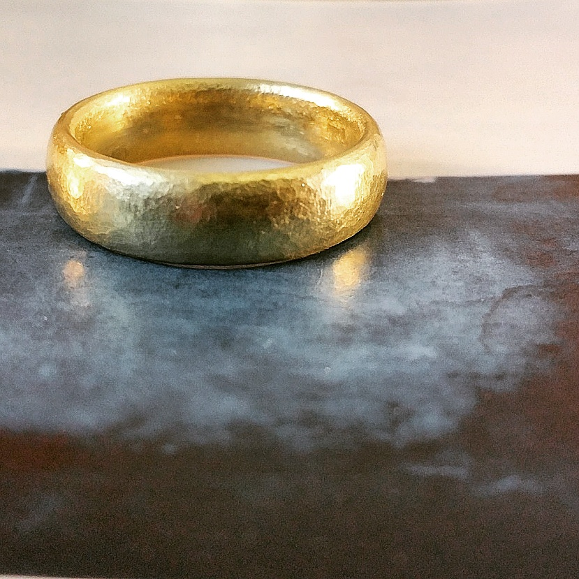 Hammered 18ct gold wedding ring.