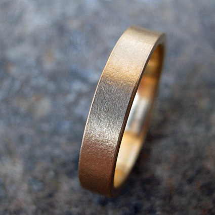 Twenty two carat yellow gold wedding ring with a delicate texture.