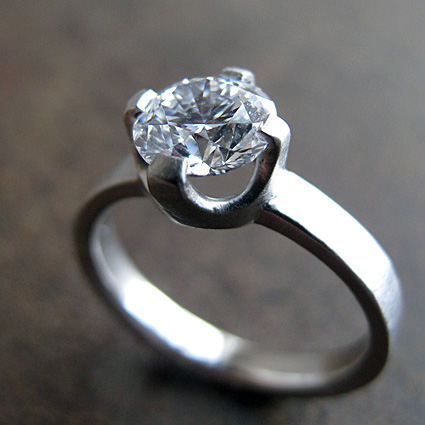 0.9 carat diamond and textured platinum engagement ring.