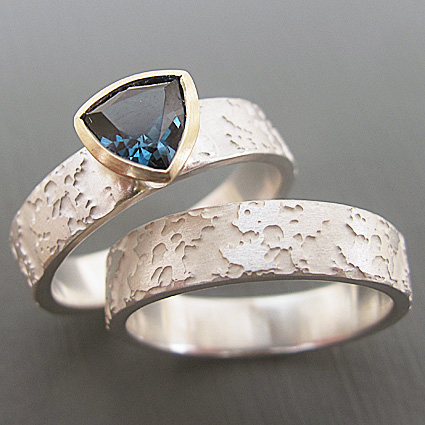 Forsythia ring with london blue topaz and 9ct yellow gold. The ring shank is etched with a pattern inspired by spring flowers.