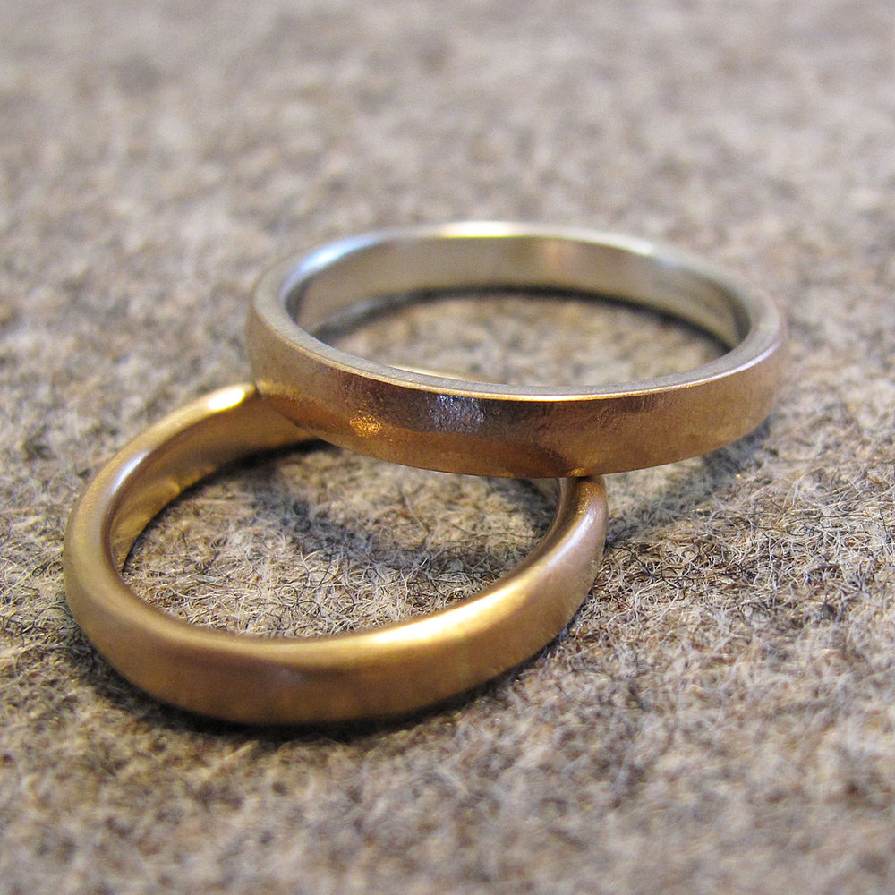 18ct rose gold and silver wedding rings.