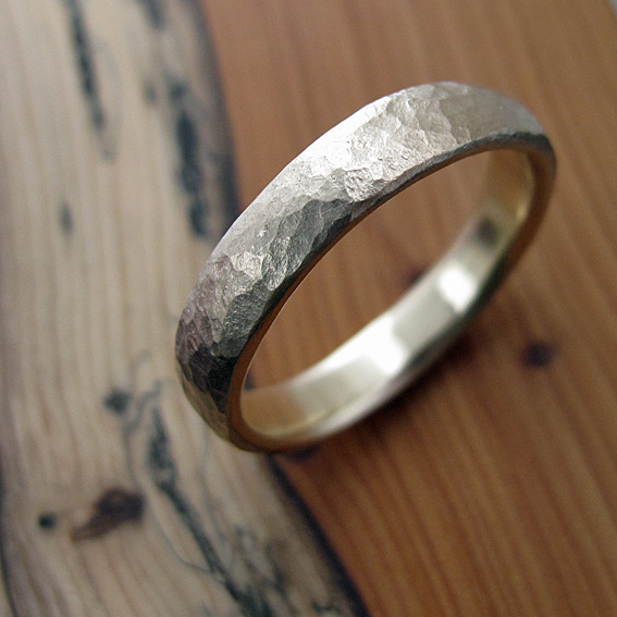 9ct yellow gold ring with a textured finish.