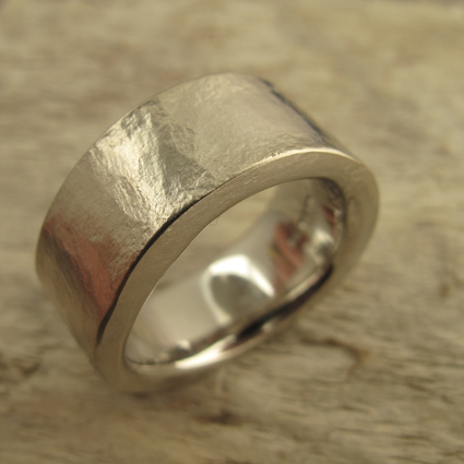 Textured, hammered platinum wedding ring.