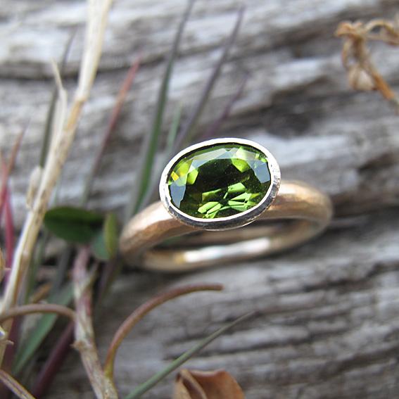 Peridot gemstone ring with organic finish in 9ct yellow gold.