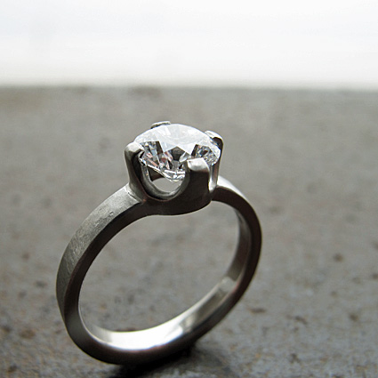 Textured platinum and Canadian diamond engagement ring.