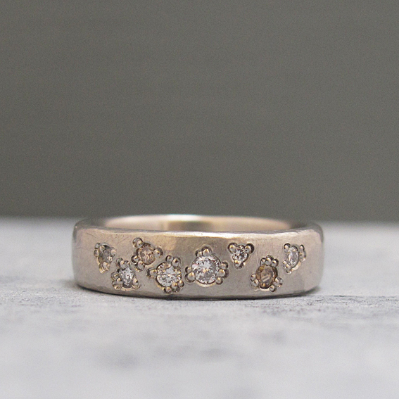 Textured platinum wedding ring.
