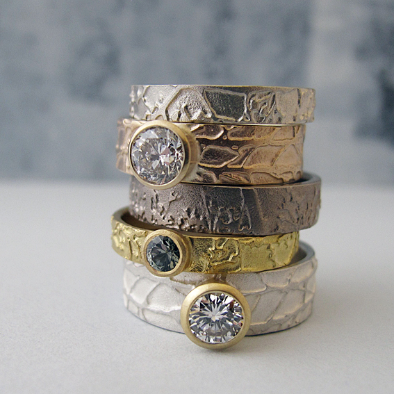 Selection of etched diamond and gemstone gold rings.