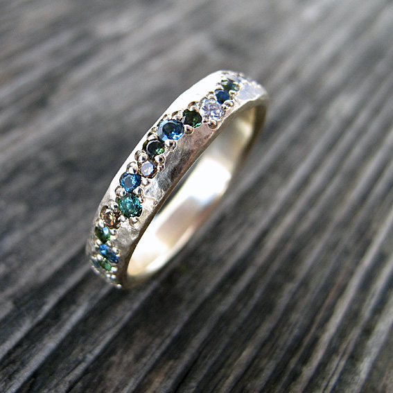 Organic pave set gemstone eternity ring.jpg