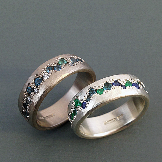 pave set organic rings sapphires emeralds diamonds topaz.jpg