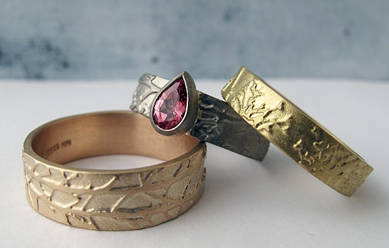 Fairtrade etched gold rings with ethically sourced sapphire.jpg