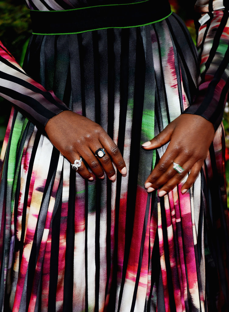 Deborah Lippmann created an anything-but-basic french manicure on Lupita with a nude base and berry tips.