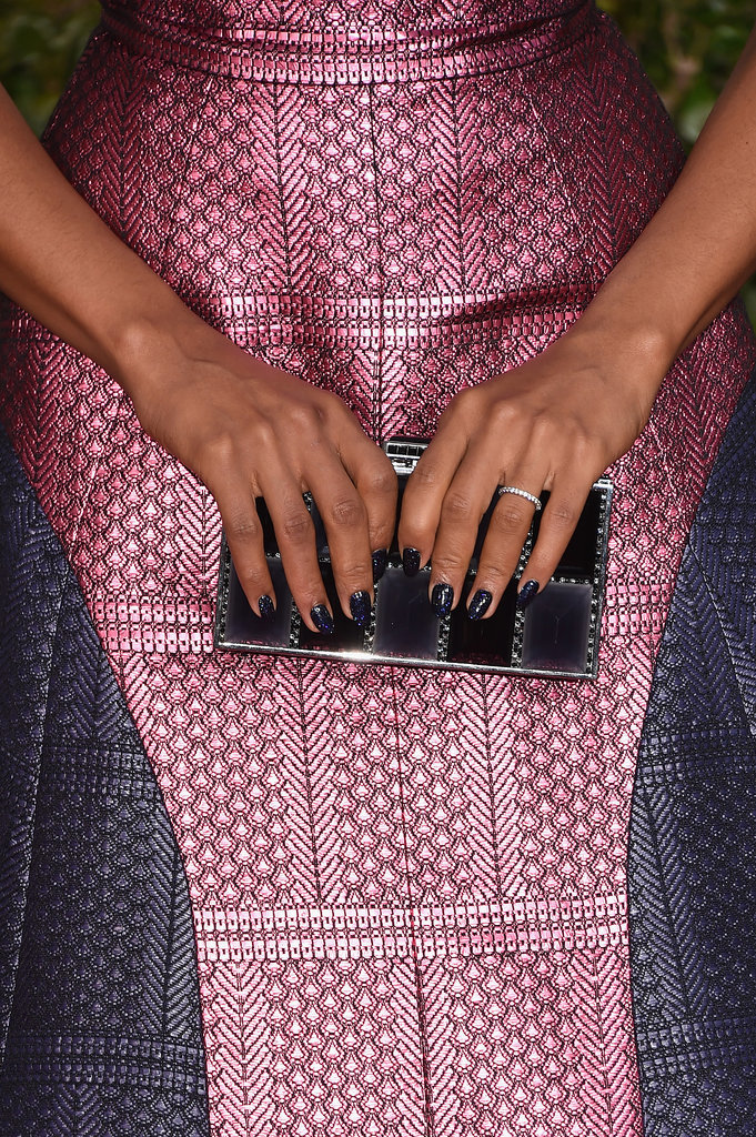 Celebrity manicurist Ashlie Johnson added glitter on top of Chanel Le Vernis in Blue Satin($27) to give Kerry Washington's Golden Globes manicure extra sparkle.