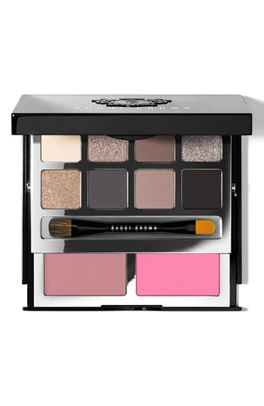 This luxe, two-tiered black palette by Bobbi Brown is packed with a mix of eight iconic and all-new eyeshadows in matte-to-metallic finishes, plus neutral and pop blush shades for a super-flattering, natural finish. Embossed with a Bobbi Brown crest, the silver interior compact includes a large mirror and dual-ended eyeliner/eyeshadow brush for flawless application. Designed to take the guesswork out of gorgeous eyes, this palette and its stunning range of colors complements all skin tones. Use them to shade, define, highlight and smoke up eyes.