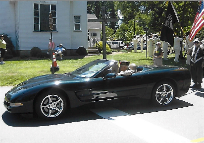 Don rides in parade courtesy of Ayer's Chevrolet
