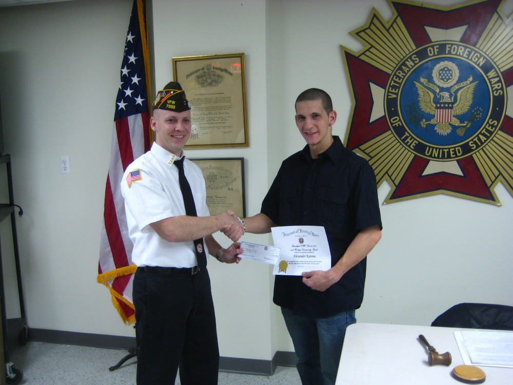Commander Scott Katona presenting Alex Katona with the Randolph VFW Post #7333, Veterans of Foreign Wars 'Veteran scholarship'