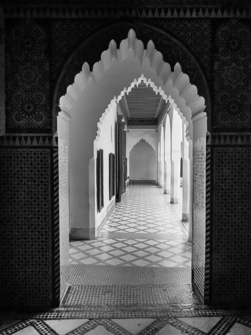 This is the interior of the Ben Youssef Madrasa, originally a college and then a sultan's palace, now a restored historic site.