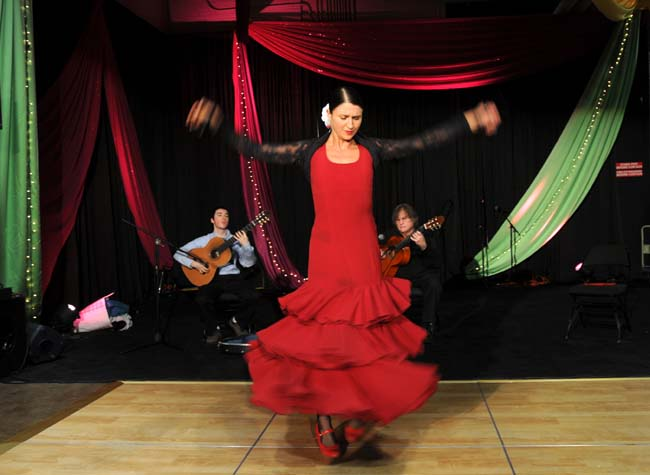 Laura Horn does a flamenco dance as Diego Rowan-Martin, left, and Michael Hauser play guitar at the Festival of Nations. Photo Credit: Pioneer Press, Chris Polydoroff