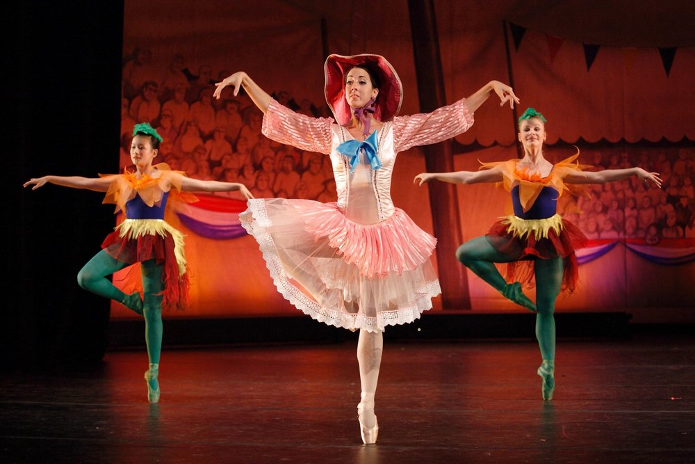 Simple backdrops used in a dance show still give a sense of place along with costumes.