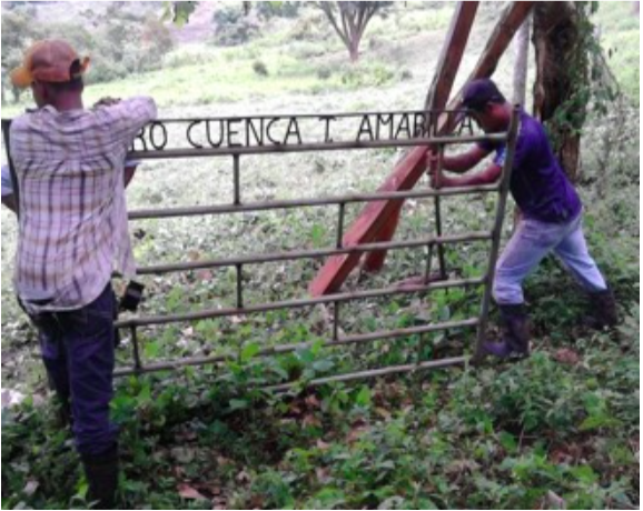 Community members post a gate to establish the boundary of the micro-watershed and keep livestock out of the tree nursery.