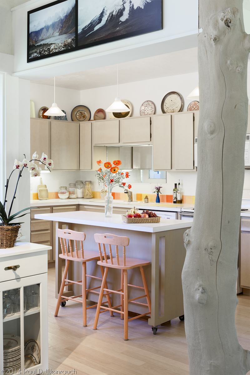 There is a real tree that grows through the middle of the kitchen, straight up through the floor and out the ceiling!