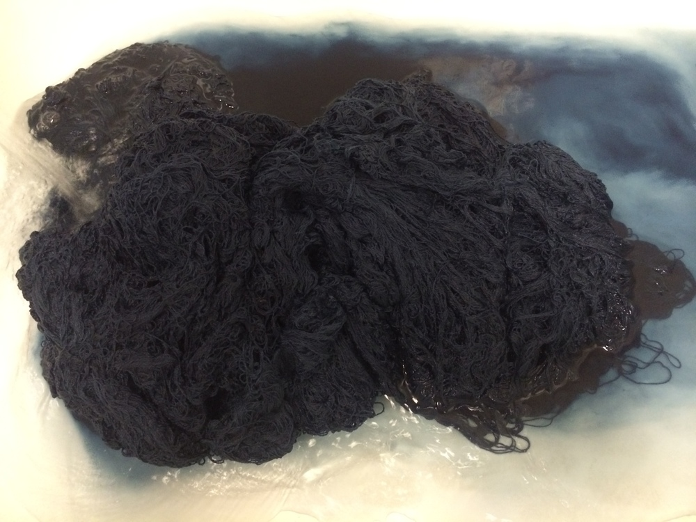 Rinsing the yarn three times to wash out the excess dye. The yarn still stays a surprisingly deep hue of blue. Eventually, we'd like to reach a point where the extra washes and rinses wouldn't be necessary. For now, it's a learning process.