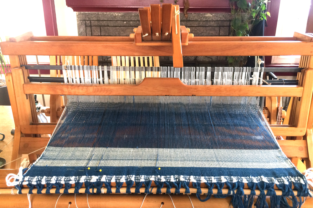 5. You can see some runs right in the beginning where some of the warp yarns broke, making an irregular pattern. These warp yarns were replaced by pinning a new yarn to the front of the fabric, threading it through the reed and the correct heddle, and then weighting it down in the back.